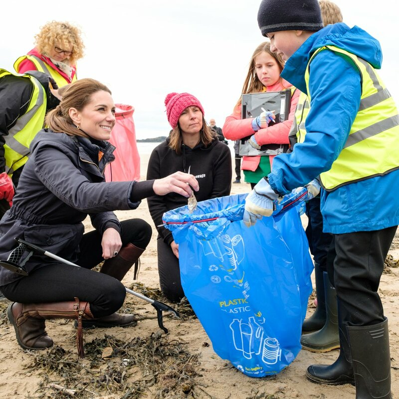 Catherin Duchess of Cambridge picks up litter on Anglesey beach.