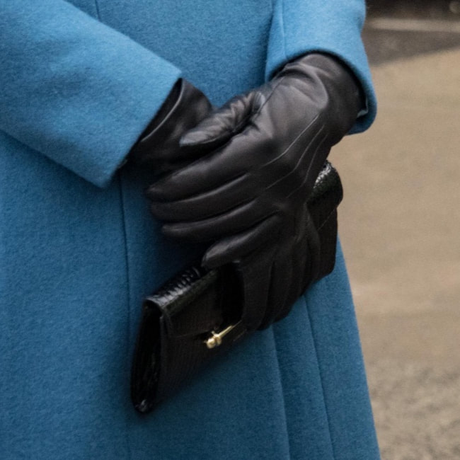 Duchess Kate carries Strathberry Multrees Chain Wallet in embossed croc black
